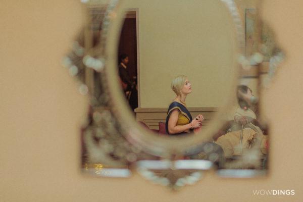 a wedding guest reflection photographed in kolkata taj hotek