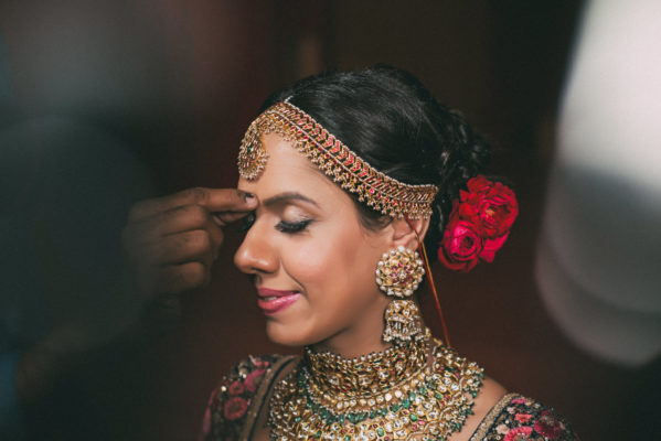 sabyasachi bride with red rose in the hair on band baaja bride show by best wedding photography in Delhi
