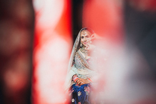 sabyasachi bride in red bokeh
