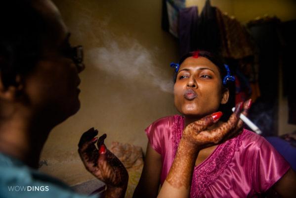 Transgender bride smoking cigarette