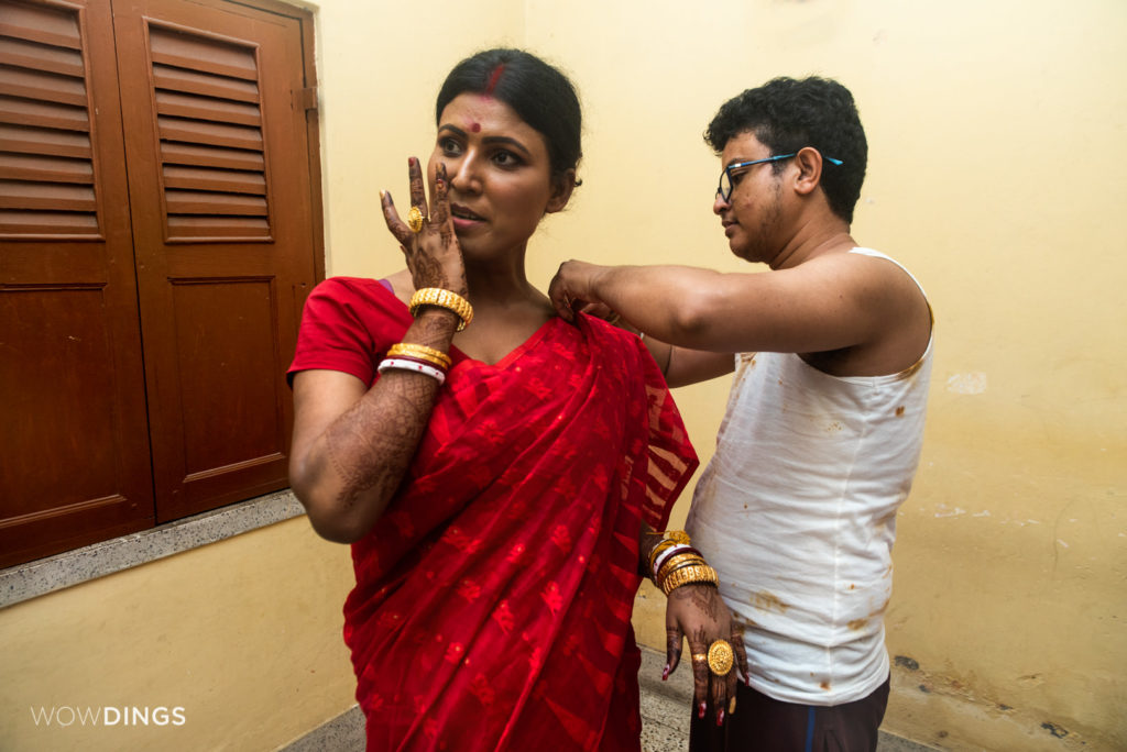Dipan helps Tista , a transgender couple, to manage her saari at their home