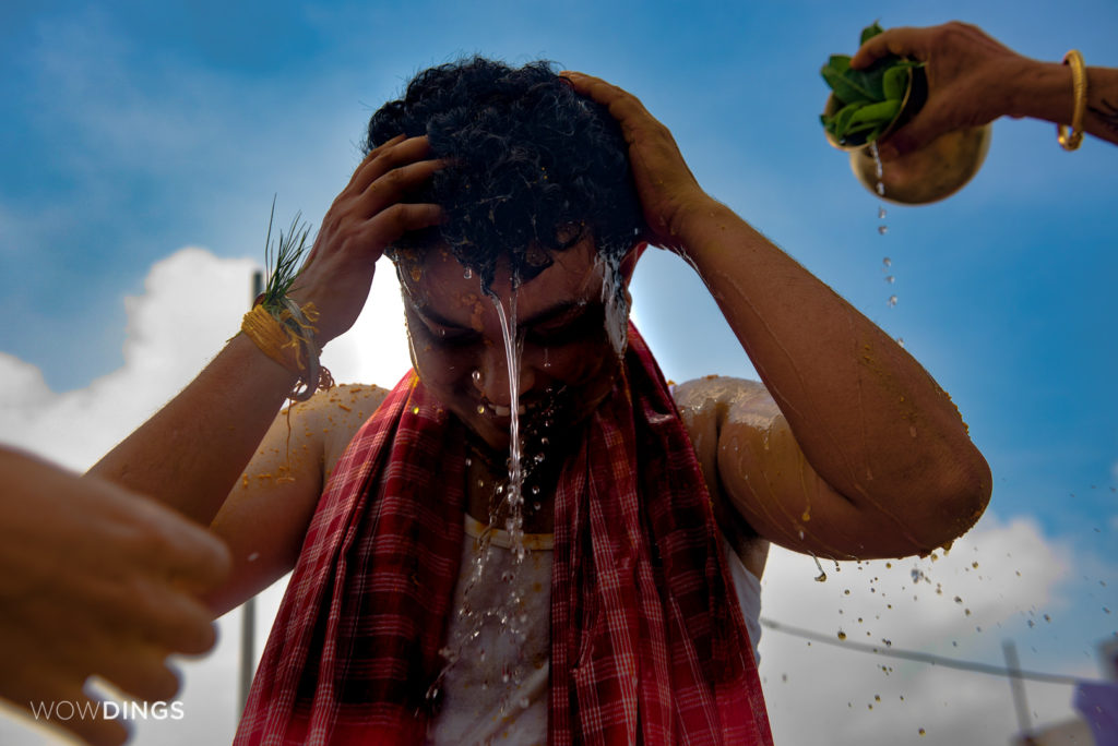 Dipan following the traditional bengali ritual of Haldi at his home