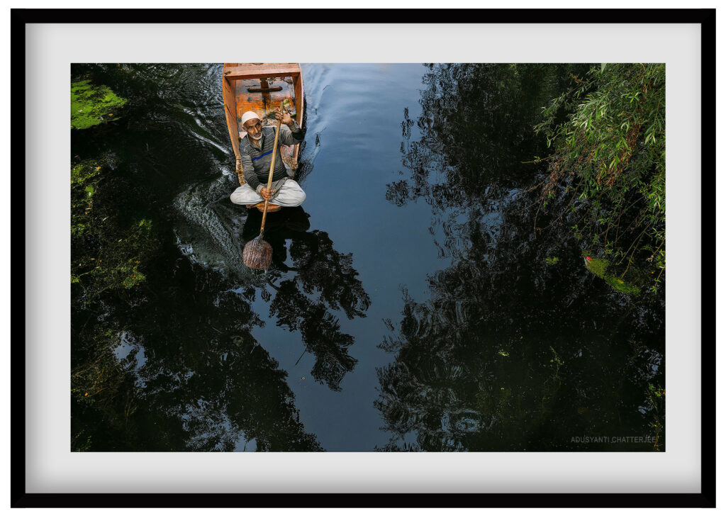 travel photography of a boatman of kashmir