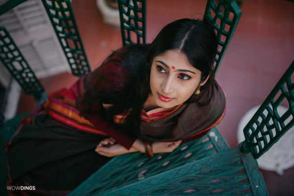 Bengali girl in a traditional saree on the stairs