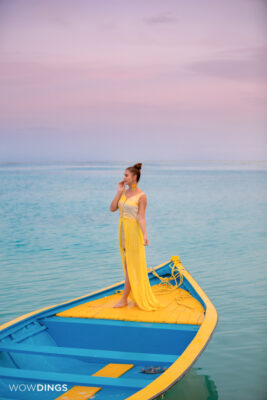girl on the boat in tellow dress